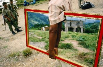 PERU. Palmapampa. 1993. Mirror vendor on a landing strip.