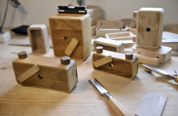 A set of wooden pinhole cameras are seen on a work-bench at the Ondu design and fabrication studio in Lopatnik